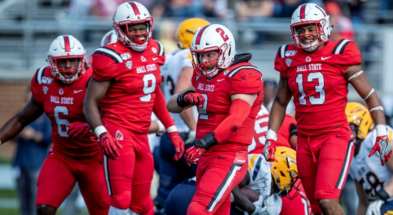 MAC-Unbeaten Cardinals Roll to 52-14 Homecoming Rout of Toledo